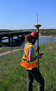GPS Surveying using TopCon Base Sation and Rover along the South Saskatchewan River in Saskatoon near the South Circle Drive Gordie Howe Bridge