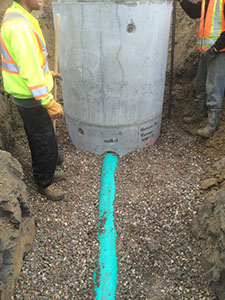 A Municipal (Civic) Storm Sewer manhole is installed by employees of Rite Choice Construction in Saskatoon Saskatchewan.